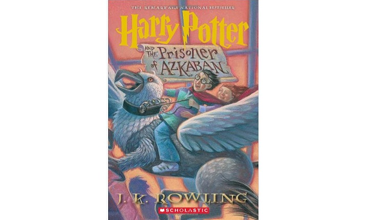 Cover art for Harry Potter and the Prisoner of Azkaban. Harry Potter rides a hippogryph.