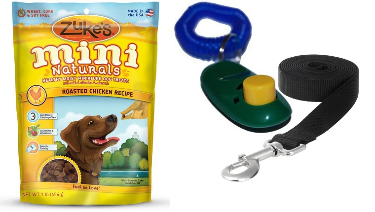 A pack of Zuke's Mini Naturals treats next to a clicker and a leash.